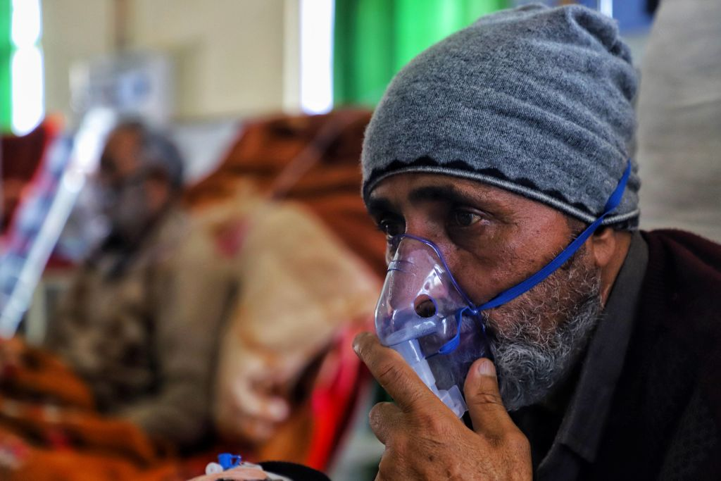 As the pandemic rages in India, Kashmir gasps for air