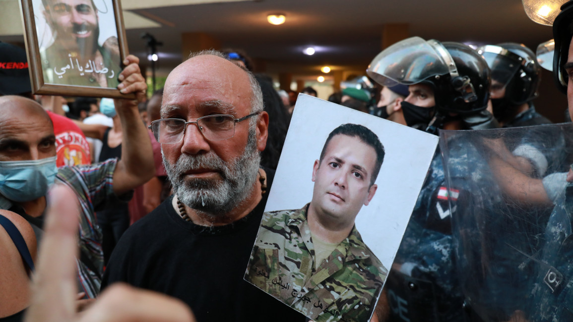 Protesters confront Lebanese Security forces outside Caretaker Interior Minister Mohammed Fahmi's home. (TNA)