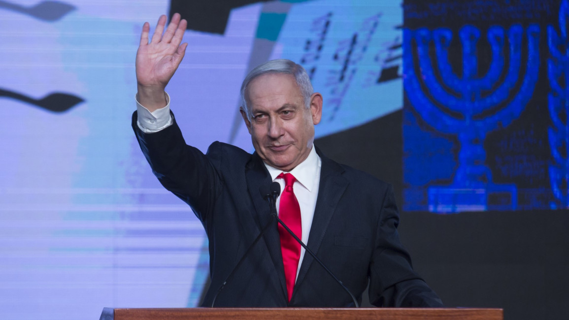 Netanyahu waving [Getty]