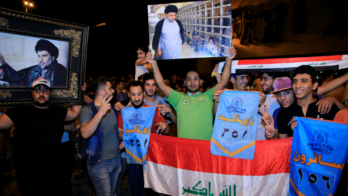 Sadr supporters celebrate after Iraq elections (Getty)