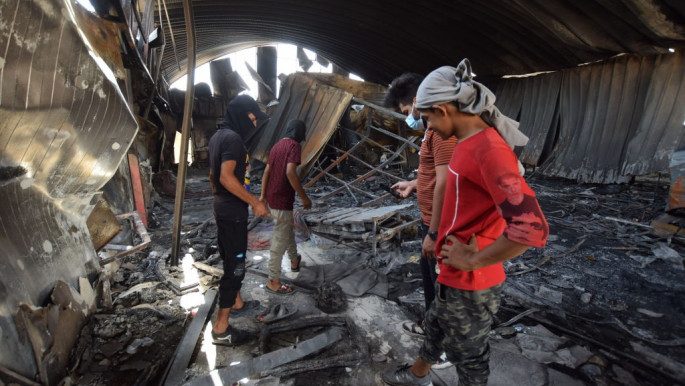 NASIRIYA, IRAQ - JULY 15: Residents inspect the damage after the deadly fire that engulfed the coronavirus isolation ward at Al-Hussein Hospital in Nasiriya city in Dhi Qar governorate, Iraq on July 15, 2021. (Photo by Arshad Mohammed/Anadolu Agency via Getty Images)