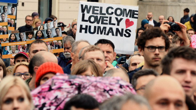 Poland has seen demonstrations in favour and against giving refuge to Syrians. [AFP]