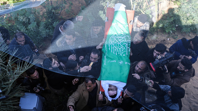 Palestinians carry the dead body of a Palestinian child killed by Israeli fire in Gaza City [Anadolu Agency/Getty]