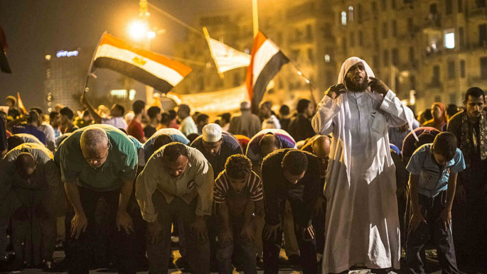 Egyptians protesters are lead in prayer during a protest against presidential candidate Ahmed Shafiq in Tahrir Square 2012