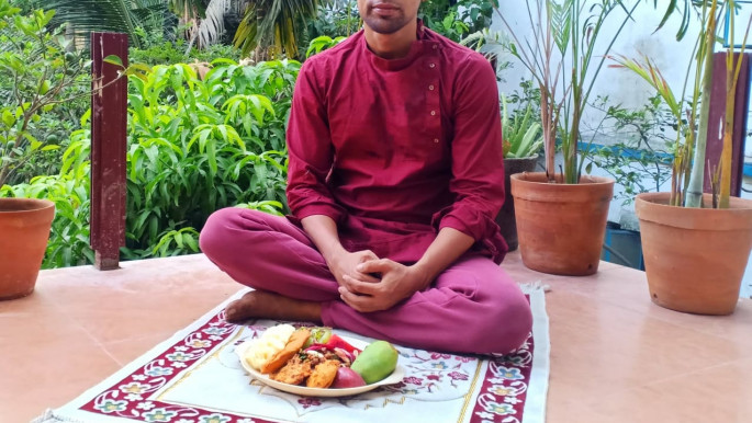 Altab Hossain with his vegan iftar waiting for maghrib adhan to break his fast. Photo by Samaira Aziz