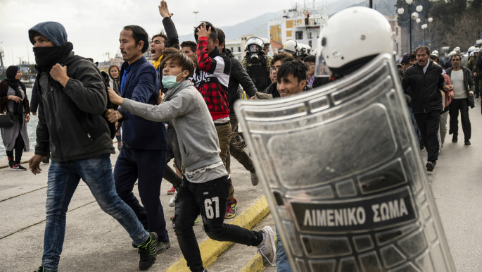 Refugees and riot police clash as tensions reach boiling point on Greek Islands