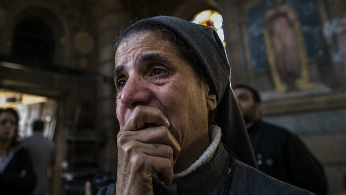 Nun reacts in aftermath of blast at Saint Peter and Saint Paul Coptic Orthodox Church