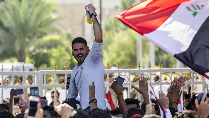 Iraqi students take part in anti-government demonstrations in front of their university in Basra. [Getty]